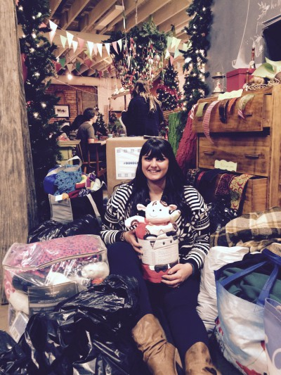 Jasmine Franklin, founder of #bundleupyeg, sits amongst a pile of donated clothing from participants of the #bundleoflove workshop on Dec. 7, 2014.