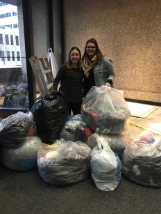 Ashley Bolduc (left) with Alberta Blue Cross collected 14 bags of donations from her friends, family and colleagues!